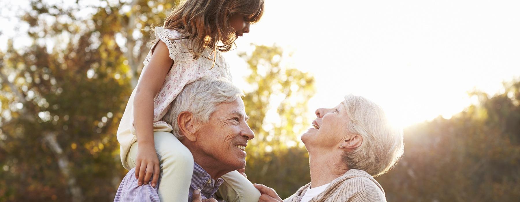 Older couple enjoying their grandchild